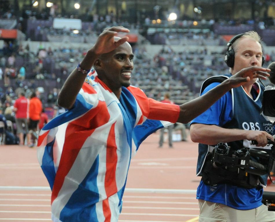 Mo Farah celebrates his double gold medal haul in London Olympics 2012
