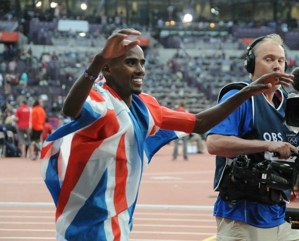 Mo Farah celebrates his double gold medal haul in London Olympics 2012