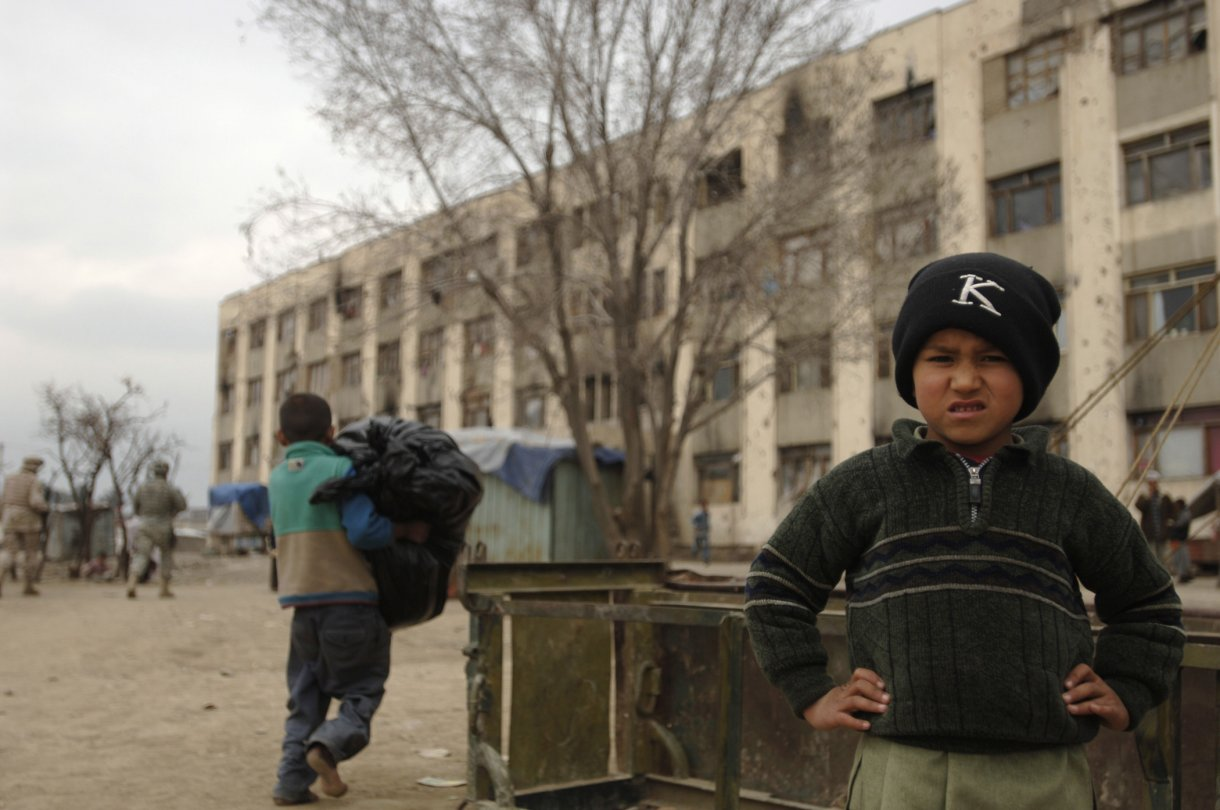 A local refugee child (not Farid) stands in front of his home, a building filled with approximately 1,000 refugees in Dar Ul Aman, Kabul, Afghanistan, April 8, 2007.