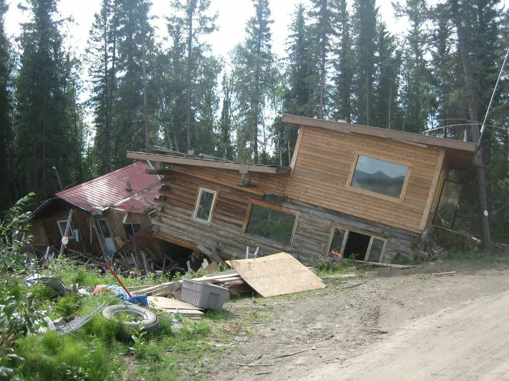 A house in Eagle, Alaska, which was pushed 300 feet off of its foundation by ice and flood waters in spring 2008