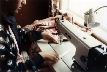 Homeworker in Bradford, UK, sewing collars for a major retailer.