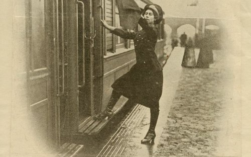 The photograph from the Electrical times, January 1917 shows a woman guard on Metropolitan Rail, part of the London underground.