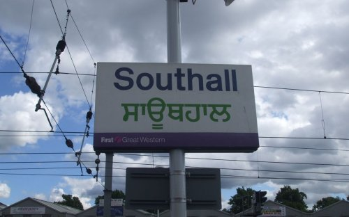 Signage on Southall station westbound slow platform, with station name in Punjabi to reflect the significant population of Punjabi Indian descent in the local West London area