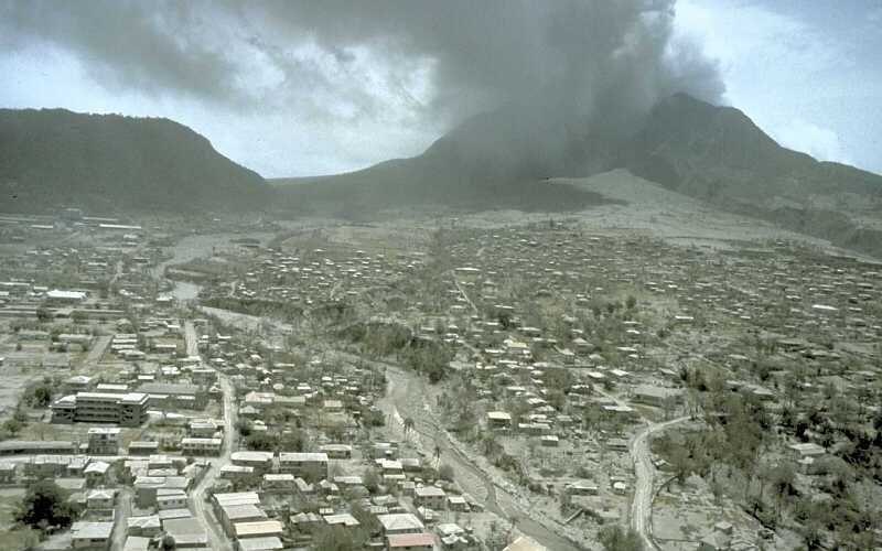 View across ash-covered Plymouth, the former capital city and major port of Montserrat, after the erusption of the volcano
