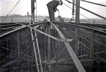 A worker on top of a gasholder being constructed in Hampshire in the 1940s
