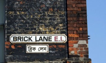 Street logo sign of Brick Lane in English and Bengali, in London