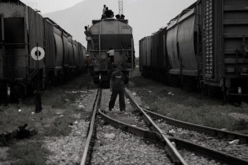 Migrants riding outside a freight train in Mexico, 2008